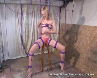 Ariel Sits On A Stool And Ties Many Ropes To Her Legs… (2015)