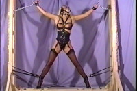 Here's a lady who's bound in rope and gagged