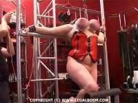 Rubber big tits torture