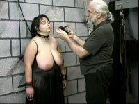Her large natural breasts are whipped and metal skewers are stuck into them