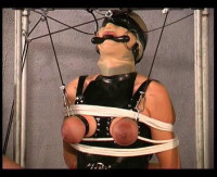 So she is tied up on one leg and clothespins are applied to her stiff nipples and labia
