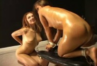 18 year old slave girl is locked to the training bench in doggie style position