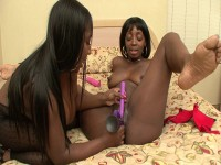 Fat ebony gets her clam drilled with two dildos