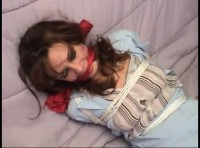 Olivia has been bound and gagged sitting on the bed