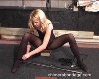 Ariel Ties A Spreader Bar Between Her Ankles… (2014)
