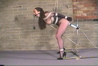 Wrapped in stockings while shes bound and gagged with rope