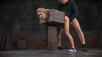 Blue eyed blonde Alina West bolted into a wooden box