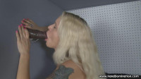 Tiny blonde sucks Enormous black Dick through a gloryhole