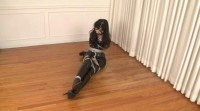 Boots and Shiny PVC in Bondage