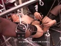 Brunette labia torture and needles (2014)