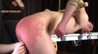 Bound naked to a bench, arse used and fingered, flogged