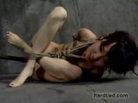 Rope around her elbows and neck. Bound in a canvas reticule