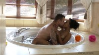 Ebony babe gives hot tub blowjob