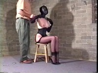 One of her legs are tied up too as the captor wants to see her cum.