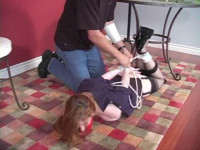 He leaves Sinn to struggle hogtied and gagged on top of the dresser