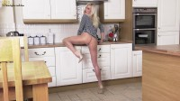 In the kitchen on the floor blonde fucks herself with a dildo