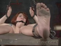 Head and ass become a mirrored centerpiece, the foci for her interrogation
