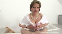 adult Sonia receives a jet of white sperm on tits
