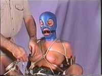 A ball gag in her mouth