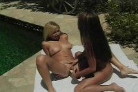 Two beautiful lesbians fucking by the pool