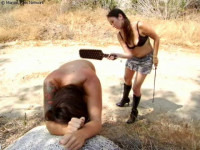 Lezdom punishment on a boulder