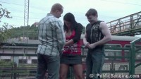 Two guys fuck girl on a railway station
