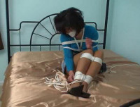 The lady is up here, gagged and tied