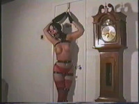Bound and ball gagged, Raven gets a tight crotch rope pulled deep