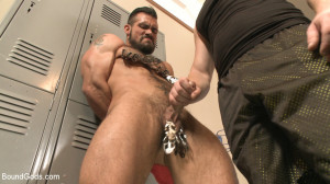 Ripped gym rat Aarin Asker takes a giant fist while in suspension