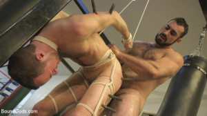 Slender stud humiliated and abused at the hands of his muscled tenant