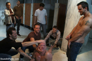 The wrestler gets gang banged by a horny crowd in a public restroom for losing his match.