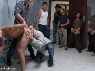 2 guys get used and abused in a public restroom.