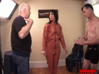 SI - Zoie in a blow up orange powerful rubber catsuit