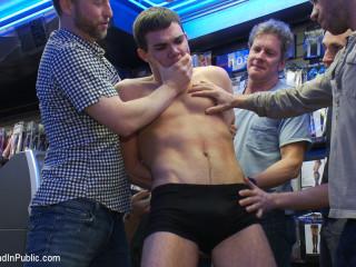 Super-naughty guys take down a cocky hustler at a busy sex arcade
