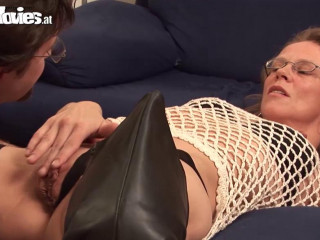 Granny using her belt cock on a stud