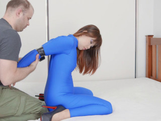 Taped In A Blue Catsuit