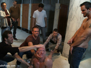 The wrestler gets gang banged by a crazy crowd in a public restroom for losing his match.
