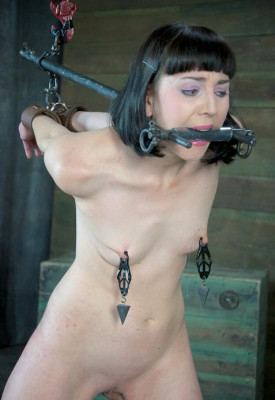 Beautiful girl in a hellish BDSM