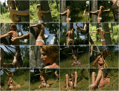 This woman is gagged and roped to a bamboo rod outside near the tiny stream