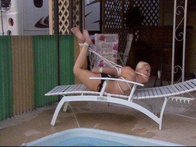 Whitney Morgan tied up in the pool and told to escape