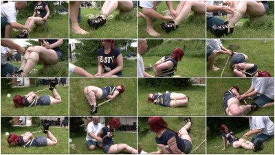 Outdoor hogtie for hot red-haired girl