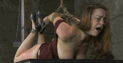 Beating Bella in bondage