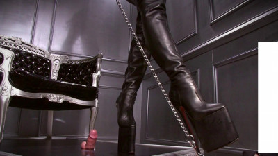 Femdom and Strapon It dominates in boots and a whip