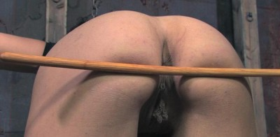 Young beauty in a super BDSM show