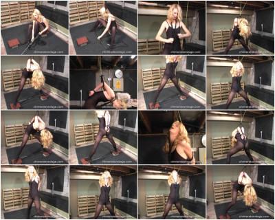 Ariel ties a spreader bar between her ankles... (2013)