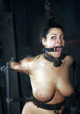 Clamps pull painfully on her nipples