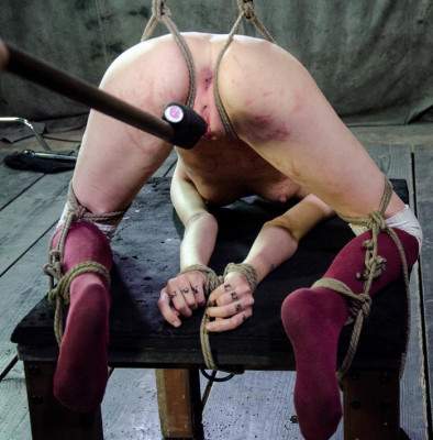 She squirms as cane strokes fall