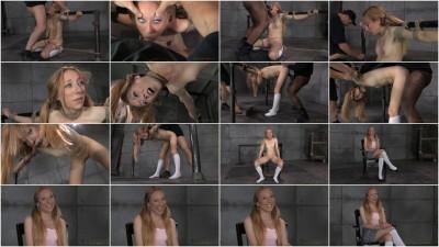 Little blonde Emma Haize bound in metal bondage