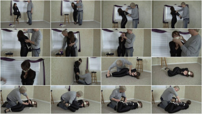Elizabeth Andrews Catsuited Domme Double Crossed (2015)