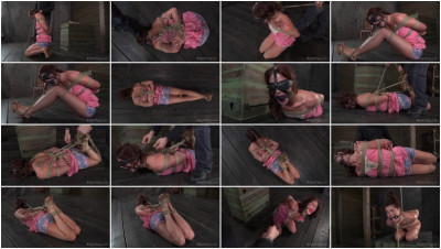 Cici Rhodes lies on the floor, bound, gagged and blindfolded